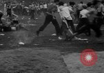 Image of shirts torn off during annual Straw Race Chicago Illinois USA, 1932, second 51 stock footage video 65675071663