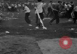 Image of shirts torn off during annual Straw Race Chicago Illinois USA, 1932, second 53 stock footage video 65675071663