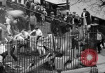 Image of shirts torn off during annual Straw Race Chicago Illinois USA, 1932, second 59 stock footage video 65675071663