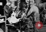 Image of Final assembly of Studebaker cars in factory South Bend Indiana USA, 1920, second 57 stock footage video 65675071731