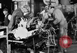 Image of Final assembly of Studebaker cars in factory South Bend Indiana USA, 1920, second 62 stock footage video 65675071731