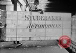 Image of Automobiles crated for export at the Studebaker factory in America United States USA, 1920, second 22 stock footage video 65675071732