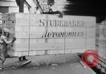 Image of Automobiles crated for export at the Studebaker factory in America United States USA, 1920, second 23 stock footage video 65675071732