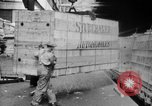 Image of Automobiles crated for export at the Studebaker factory in America United States USA, 1920, second 25 stock footage video 65675071732