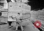 Image of Automobiles crated for export at the Studebaker factory in America United States USA, 1920, second 26 stock footage video 65675071732