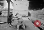Image of Automobiles crated for export at the Studebaker factory in America United States USA, 1920, second 27 stock footage video 65675071732