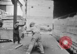 Image of Automobiles crated for export at the Studebaker factory in America United States USA, 1920, second 28 stock footage video 65675071732