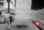 Image of Automobiles crated for export at the Studebaker factory in America United States USA, 1920, second 30 stock footage video 65675071732