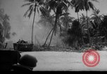 Image of Marines in landing vehicle tracked (LVT) during amphibious assault Pacific Theater, 1944, second 60 stock footage video 65675071826