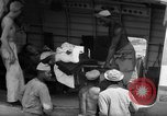 Image of Injured  U.S.prisoners of war removed from air evacuation planes Leyte Philippines, 1945, second 21 stock footage video 65675071949