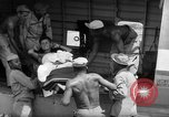 Image of Injured  U.S.prisoners of war removed from air evacuation planes Leyte Philippines, 1945, second 25 stock footage video 65675071949