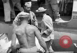 Image of Injured  U.S.prisoners of war removed from air evacuation planes Leyte Philippines, 1945, second 32 stock footage video 65675071949