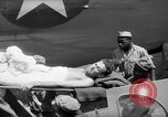 Image of Injured  U.S.prisoners of war removed from air evacuation planes Leyte Philippines, 1945, second 34 stock footage video 65675071949
