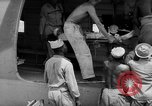Image of Injured  U.S.prisoners of war removed from air evacuation planes Leyte Philippines, 1945, second 46 stock footage video 65675071949