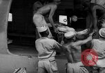 Image of Injured  U.S.prisoners of war removed from air evacuation planes Leyte Philippines, 1945, second 48 stock footage video 65675071949