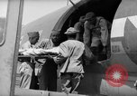 Image of Injured  U.S.prisoners of war removed from air evacuation planes Leyte Philippines, 1945, second 56 stock footage video 65675071949