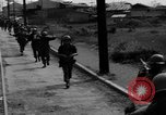 Image of Elements of the U.S. 1st Cavalry Division advancing  Manila Philippines, 1945, second 6 stock footage video 65675071952