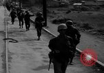 Image of Elements of the U.S. 1st Cavalry Division advancing  Manila Philippines, 1945, second 11 stock footage video 65675071952