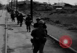 Image of Elements of the U.S. 1st Cavalry Division advancing  Manila Philippines, 1945, second 13 stock footage video 65675071952