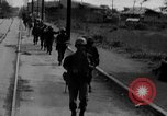 Image of Elements of the U.S. 1st Cavalry Division advancing  Manila Philippines, 1945, second 15 stock footage video 65675071952