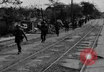 Image of Elements of the U.S. 1st Cavalry Division advancing  Manila Philippines, 1945, second 16 stock footage video 65675071952