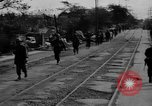 Image of Elements of the U.S. 1st Cavalry Division advancing  Manila Philippines, 1945, second 17 stock footage video 65675071952