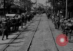 Image of Elements of the U.S. 1st Cavalry Division advancing  Manila Philippines, 1945, second 20 stock footage video 65675071952