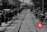 Image of Elements of the U.S. 1st Cavalry Division advancing  Manila Philippines, 1945, second 21 stock footage video 65675071952
