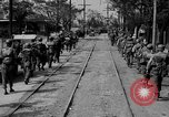 Image of Elements of the U.S. 1st Cavalry Division advancing  Manila Philippines, 1945, second 22 stock footage video 65675071952