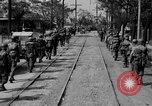 Image of Elements of the U.S. 1st Cavalry Division advancing  Manila Philippines, 1945, second 23 stock footage video 65675071952