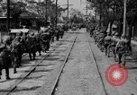 Image of Elements of the U.S. 1st Cavalry Division advancing  Manila Philippines, 1945, second 25 stock footage video 65675071952
