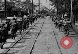 Image of Elements of the U.S. 1st Cavalry Division advancing  Manila Philippines, 1945, second 26 stock footage video 65675071952