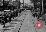 Image of Elements of the U.S. 1st Cavalry Division advancing  Manila Philippines, 1945, second 27 stock footage video 65675071952