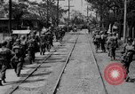 Image of Elements of the U.S. 1st Cavalry Division advancing  Manila Philippines, 1945, second 28 stock footage video 65675071952