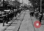 Image of Elements of the U.S. 1st Cavalry Division advancing  Manila Philippines, 1945, second 29 stock footage video 65675071952