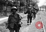 Image of Elements of the U.S. 1st Cavalry Division advancing  Manila Philippines, 1945, second 30 stock footage video 65675071952