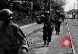 Image of Elements of the U.S. 1st Cavalry Division advancing  Manila Philippines, 1945, second 31 stock footage video 65675071952
