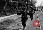 Image of Elements of the U.S. 1st Cavalry Division advancing  Manila Philippines, 1945, second 32 stock footage video 65675071952