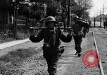 Image of Elements of the U.S. 1st Cavalry Division advancing  Manila Philippines, 1945, second 33 stock footage video 65675071952