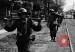 Image of Elements of the U.S. 1st Cavalry Division advancing  Manila Philippines, 1945, second 34 stock footage video 65675071952