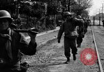 Image of Elements of the U.S. 1st Cavalry Division advancing  Manila Philippines, 1945, second 35 stock footage video 65675071952