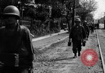 Image of Elements of the U.S. 1st Cavalry Division advancing  Manila Philippines, 1945, second 42 stock footage video 65675071952
