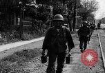 Image of Elements of the U.S. 1st Cavalry Division advancing  Manila Philippines, 1945, second 45 stock footage video 65675071952