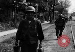 Image of Elements of the U.S. 1st Cavalry Division advancing  Manila Philippines, 1945, second 46 stock footage video 65675071952