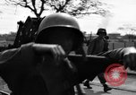 Image of Elements of the U.S. 1st Cavalry Division advancing  Manila Philippines, 1945, second 50 stock footage video 65675071952