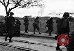 Image of Elements of the U.S. 1st Cavalry Division advancing  Manila Philippines, 1945, second 51 stock footage video 65675071952