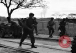 Image of Elements of the U.S. 1st Cavalry Division advancing  Manila Philippines, 1945, second 52 stock footage video 65675071952