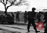 Image of Elements of the U.S. 1st Cavalry Division advancing  Manila Philippines, 1945, second 53 stock footage video 65675071952
