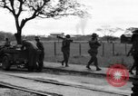Image of Elements of the U.S. 1st Cavalry Division advancing  Manila Philippines, 1945, second 54 stock footage video 65675071952