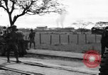 Image of Elements of the U.S. 1st Cavalry Division advancing  Manila Philippines, 1945, second 58 stock footage video 65675071952